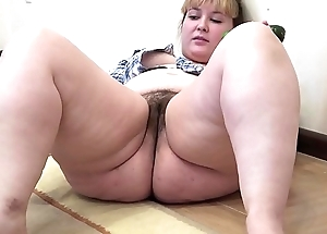 A chunky doll far a flimsy cum-hole masturbates far a cucumber
